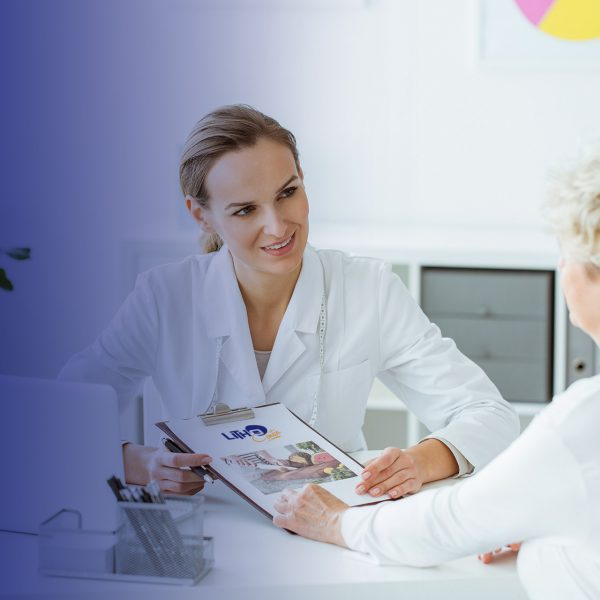 Smiling dietitian holding diet plan during consultation with patient in the office with laptop on desk